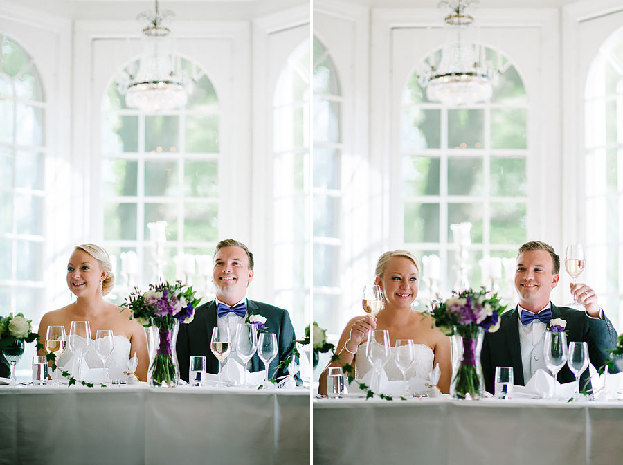 Bröllop på Villa Odinslund - brudparet skålar vid bordet